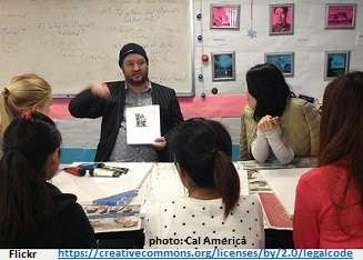 Teacher demonstrating an ESL picture activity to his class.