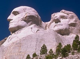 photo of Mt. Rushmore and the carved faces of Washington and Jefferson