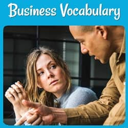 Business Vocabulary. Photo of a young man and woman possibly discussing business plans.