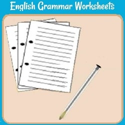 English Gramar Worksheets: a desk or other surface with several binder worksheets and a pen