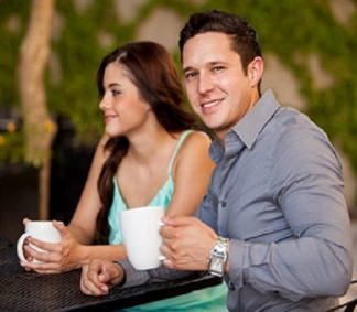 man and woman having coffee together and making small talk.