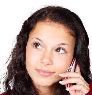 girl listening on a cell phone