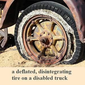 example of negative prefixes from the prefix list: a deflated, disintegrating tire on a disabled truck