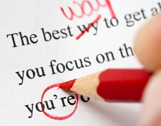 proofreading with a red pencil